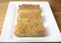 Prot: 9 g, Carbs: 2 g, Fat: 2 g, Cal: 56 If you're trying to keep your carbs low for fat loss, you must try my protein breads! This Garlic Protein Bread is the perfect addition to a great salad, a warm bowl of soup, or your favorite veggie