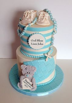 - Baptism cake. Decor designed around baby's actual booties and rosary. Rosary is fondant pearls strung on floss to make it moveable. I love how it turned out.