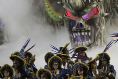 Performers from the Vila Isabel samba school parade during carnival celebrations at the Sambadrome in Rio de Janeiro, on February 16, 2015.