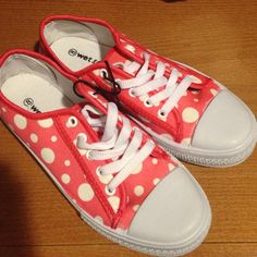 Polka Dot Sneakers NWT coral colored lace up low tops. Have some tiny white scuffs on the toes as shown, but never worn. Shoes Sneakers