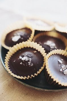 These are like reese cups, but with almond butter. The look of them gave me an idea to coat a cupcake liner with white chocolate. After it hardens, fill it with a ganache or another dark chocolate filling.