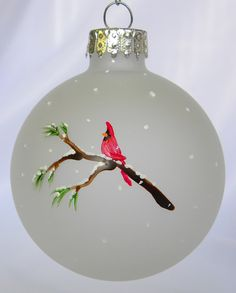 This hand painted Christmas ornament is perfect for the bird lover! Each ornament measures 2 5/8 and is hand painted on a frosted glass