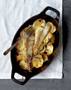 Baked cod fillets with potatoes for the Greek Palm Sunday