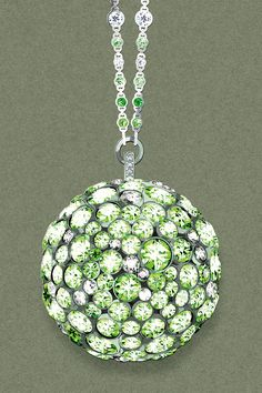 From the 2016 Masterpieces Collection, this pendant in platinum with tsavorites and diamonds celebrates the brilliant bursts of color in Louis Comfort Tiffany's famed stained-glass work. Illustration by François Berthoud.
