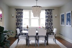 Beaded chandelier, bold drapery pattern.  Navy dining room.