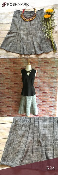"""Ann Taylor tweed Aline skirt This tweed Aline skirt has a flirty hem line and a super flattering fit. In excellent condition.  Fully lined. 100% virgin wool. Acetate lining. 24.5"""" 16.5"""" waist laying flat. Size 12. *Black Peplum Top is also available in my closet, buy the look and save! Ann Taylor Skirts A-Line or Full"""