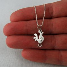 rooster love♥...my daughter came over this evening and surprized me with this ADORABLE necklace.