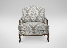 Sat in the Versailles Chair from Ethan Allen last weekend and it is so comfy and classic looking. I would do a different fabric though.