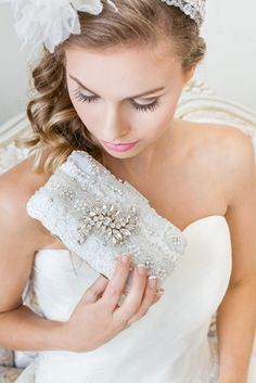 Carry all your wedding day essentials in a gorgeous bridal clutch. See more here: http://www.cloenoeldesigns.com