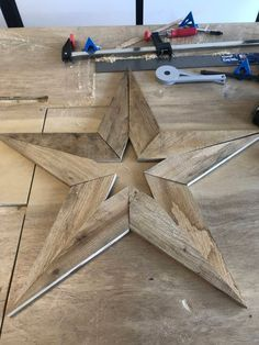 Reclaimed wood star <br> Reclaimed wood star from pallets. Unique and hand made. Measures x Perfect for Christmas or year round decorations. Made with indoor/outdoor rating glue and biscuit joinery for strong construction. Reclaimed Wood Projects, Small Wood Projects, Scrap Wood Projects, Easy Woodworking Projects, Salvaged Wood, Woodworking Plans, Repurposed Wood, Woodworking Furniture, Outdoor Wood Projects