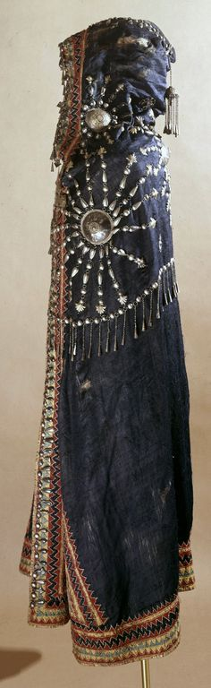 Africa | 19th century robe from Ethiopia | Silk with embroidered designs in silk thread and further decorated with appliqued filigree and reepoussé worked silver gilt ornaments. | ca. 1868 or earlier