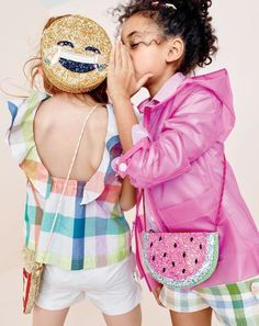 crewcuts girls' ruffle-back top in gingham, bow short, water-resistant rain jacket, Thomas Mason® for crewcuts Ludlow shirt, bow short in gingham and laughing emoji, pizza slice and watermelon glitter bags.