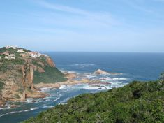 View of the heads and entrance to Indian Ocean - Knysna, South Africa Places To Travel, Places To See, What To Do Today, Knysna, Amazing Destinations, Continents, South Africa, Trip Advisor, The Good Place