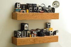 I want at least 2 shelves that look like this in my house! LOVE antique/vintage cameras and equipment!!!