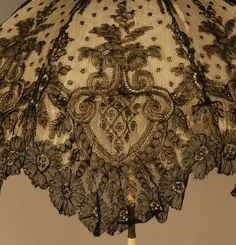hats and laces — Folding chantilly lace parasol with carved ivory...