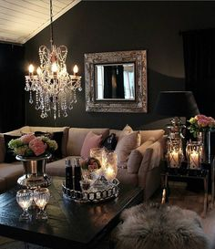 I like the dark walls/low chandelier, everything else is too foofy