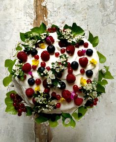 A cake  covered in berries ... so pretty.