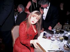 Stevie Nicks-love the red, love the expression! Stevie never takes a bad photo.