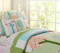 I love the Brooke Quilted Bedding on potterybarnkids.com - Also like the blues and greens of this one for O