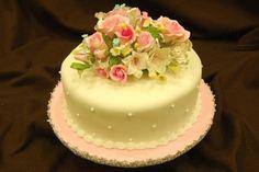 single wedding cakes | Single yellow wedding cake with flowers on top