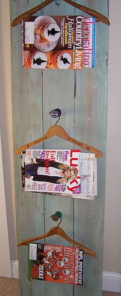 Magazine rack, but could possibly be used to display kids art...perfect behind a door in a potty room...