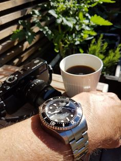 Rolex deep sea dweller . Black and white  Coffee and Rolex Enjoying the #sun  #watchandcoffee #daily #deepsea #deepdiving #denmark #dagenswristshots #tomato #crystal #badboy