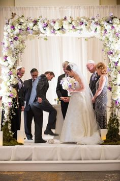 love the floral archway design decorating this chuppah at a jewish wedding