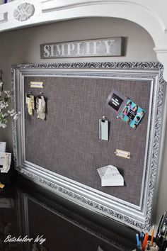 Old picture frame, cardboard, cork squares and fabric - easy.    Batchelors Way: Office Redo - Pin Board of Dreams