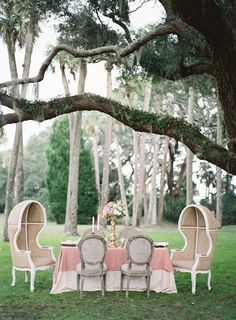 Outdoor celebration with a sweetheart table featuring balloon chairs | http://www.adornmagazine.com | Amanda Watson Photography