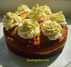 Loveliest Lemon Curd Cake a whole cake baked with lemon that is then halved on cooling sandwiched together with tart lemon curd and topped with lemon swirls
