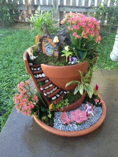 Everyone loves the tiny plantings and accessories in a fairy garden. The latest trend involves building that miniature landscape in a broken pot. Here are examples and tips for this.