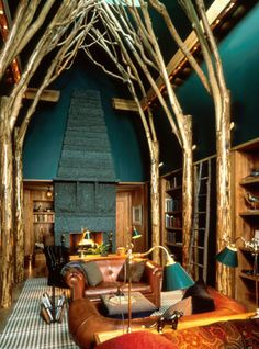 A magical libray: The three-story-high arched ceiling is filled with branches springing from the tops of natural ceder posts. Lodge : Marsh Estate Photography © Norman McGrath, Scott Frances