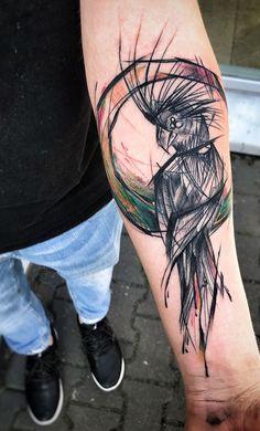 Inez Janiak parrot tattoo
