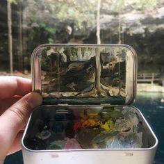 Colorado-based artist Heidi Annalise creates impressionistic landscapes inside the lids of old mint tins, using the base to mix her paints.