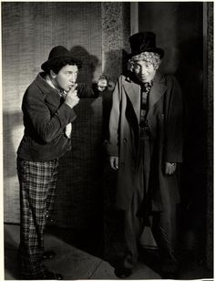 Chico & Harpo Marx in production still from Duck Soup (1933, dir. Leo McCarey), black and white, photography, comedian, actor, man, hat, schyy, silence, be quiet, funny
