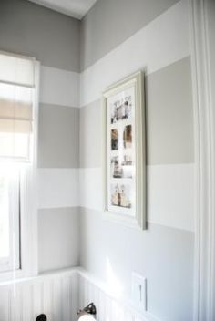 This paint is in a bathroom but I really want to do neutral stripes like this in Owen's room.