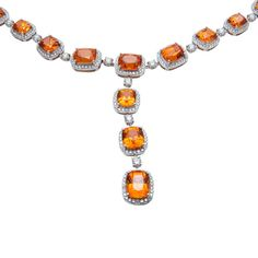 Spessartite garnet and diamond necklace and earring set.