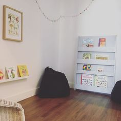 Montessori home ideas - front-facing bookshelves in a reading nook.