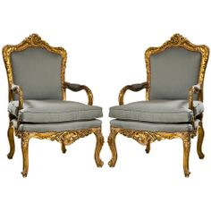 This is a pair of French Rococo Revival Style  Fauteuils arm chairs. There is ornamentation on the seat rail and the top of the crest rail, which was a common detail with these chairs. They also have the small upholstered arm cushions that were popular during this time. These actually look pretty comfortable!