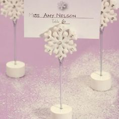 Let it snow, Let it snow, Let it snow with these snowflake place card holders on your guests' tables. It's easy to transform your reception hall into a winter wonderland with these unique snowflake place card holders. Each features a white base and a single snowflake gracefully sitting atop a metal stand. Perfect for displaying winter wedding or event seating arrangements and for holding a photo or note in your guests' homes, each is 4.5″ tall. These attractive snowflake place card holders…