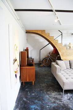 retro interior design inspiration - loving that mid century sideboard and the round stair design