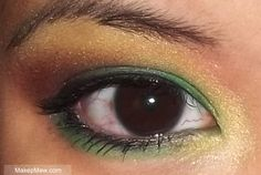 green, yellow and red eye makeup tutorial. make the red a bit more vibrant and you have flamboyant christmas eyes.
