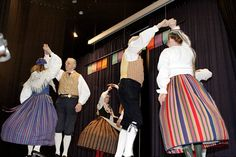 Folk dancing! I don't know much about the folk costumes the men are wearing so I won't comment on that, but the woman on the left is wearing a Finn-Swedish folk dress from Borgå. The woman on the right is wearing a Karelian dress from the island Seiskari. The folk dress in the middle is also Finn-Swedish, from Sibbo. Photo: Ulla Mether