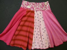 This upcycled Strawberry Shortcake Twirly Skirt was made completely with recycled t-shirts. The waistband is cotton/lycra for a good fit. Like all Twinkle skirts and dresses it is one of a kind and its seams are serged and professionally finished. Because of the elasticity of the waist, these skirts fit a variety of sizes and fit for a long time. This one will fit a 7, 8 or 9 year old and measures as follows: waist: 20 in. (stretches to 24 in) length: 15 in Twinkle Twirly Skirts a...