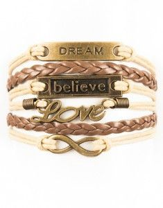 """With the signature believe charm, this cross and fish bracelet will take center stage. Delicate with braided strap details, layer your look with other favorites from Modestly. - Size: 6"""" long with a 2"""