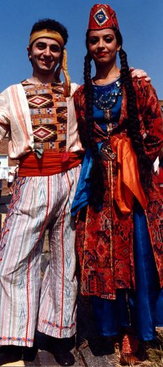 A couple in Western Armenian costumes (region of the Van Lake).  Clothing style: early 20th century.  These are recent workshop-made copies, as worn by folk dance groups.