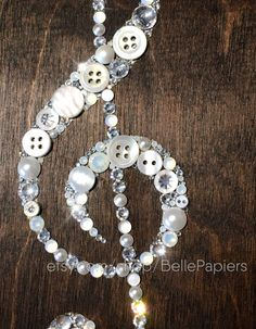 Button Art Treble Clef | Button Canvas Music Note | Gifts for Musicians | Sheet Music Art | Button Canvas | Button Picture | Button & Swarovski Art To see a video of this pieces sparkle, make sure HD is on and visit this link: https://www.facebook.com/bellepapiers/videos/531786940327423/ Each Button & Swarovski Crystal Treble Clef is 5x7 and will arrive to you in 2-3 days (US only, international 6-20 days), packed with care. If youre pleased with the photos of my work, you will not…