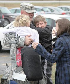 @Minnesota National Guard Sgt. Maj. Matt Thornwall is greeted by three of his children (left to right) — Elizabeth, Jonathan, and Emily — after arriving home after a nearly year-long deployment.