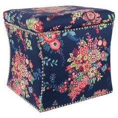 """Bring garden-chic style to your living room or master suite with this lovely ottoman, showcasing a tufted top and medallion-inspired floral upholstery. Handmade in the USA.   Product: Storage ottomanConstruction Material: Solid pine wood, polyurethane and polyester fill foamColor: NavyFeatures:  Handmade in the USATufted top Dimensions: 19"""" H x 19"""" W x 17"""" DCleaning and Care: Spot clean only"""