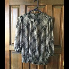 Sheer Top One button pink, gray and black plaid print shirt. Mid sleeve gathering at end of sleeves and waist. Tops Blouses